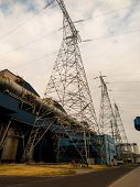 foto of power transmission lines  - electrical power plant with high voltage transmission lines and pylons - JPG
