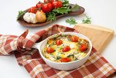 image of baby goat  - Closeup of pan with fresh made frittata with baby kale sundried tomatoes and goat cheese - JPG