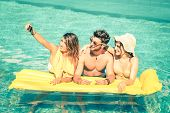 stock photo of mans-best-friend  - Best friends taking selfie at swimming pool with yellow airbed  - JPG
