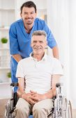 picture of male nurses  - Male nurse talking with senior patient in wheelchair - JPG