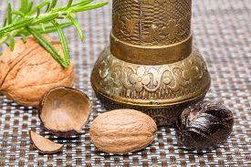 stock photo of musky  - Bio nutmeg with grinder walnuts and rosemary - JPG