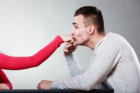 foto of politeness  - Polite man husband kissing woman hand palm - JPG