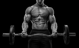 pic of bicep  - Closeup portrait of a muscular man workout with barbell at gym - JPG