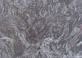 picture of porphyry  - rectangular slate of wavy purple gray marble - JPG