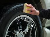 pic of car wash  - car wheel and hand the men rubbing tires - JPG