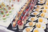 Beautifully Decorated Catering Banquet Table With Different Food Snacks And Appetizers On Corporate poster