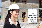 Hispanic woman on construction site