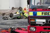 Fire And Rescue Service Staff At Car Crash