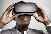 People, Technology, Cyberspace, Innovation And Gaming Concept. Happy Successful African Businessman poster