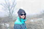 Beautiful Girl In Sunglasses And Winter