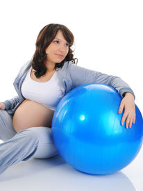 foto of pregnancy exercises  - Beautiful pregnant woman sitting with exercise ball - JPG