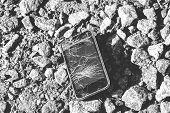 Broken Smartphone. Smartphone With Broken Screen On Crushed Stone poster