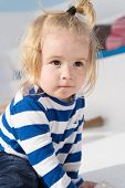 Child. Cute Child In Striped Clothes. Happy Childhood Of Little Boy Child. Child With Blong Hair. St poster