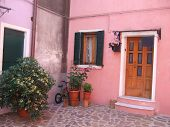 Front entrance of a pastel colored home on Burano, the lace-making island off the coast of Venice, I