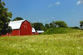 Large red barn with white roof.