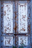 Texture Of A Wooden Door. A Wooden Door With Peeling Paint. The Old Paint Will Climb From The Old Wo poster