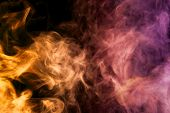 Dense Multicolored Smoke Of   Pink, Orange And Purple Colors On A Black Isolated Background. Backgro poster