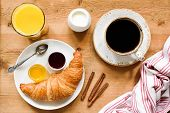 Breakfast Table With Coffee, Croissant, Jam, Orange Juice And Jam. Tasty Breakfast On Wooden Table,  poster