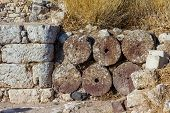 Ancient Stone Masonry And Round Volcanic Stone Ruins And Remainings, Santorini, Greece poster