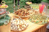 Candy Bar And Wedding Cake. Table With Sweets, Buffet With Candies, Dessert. poster