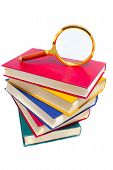 Pile Of Books And Magnifier
