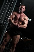 Male Fitness Model With Naked Torso Showing Sixpack Abdominal And Muscular Body. poster