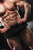 Close-up - High Level Bodybuilder With Naked Torso Showing Sixpack Abdominal And Muscular Body. poster