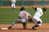 MESA, AZ - NOVEMBER 4: Salt River Rafters outfielder Jake Goebbert slides into Mesa Solar Sox infiel