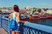 Young Tourist Woman On Galata Bridge, Golden Horn Bay, Istanbul. Panorama Cityscape Of Famous Touris poster