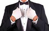 Man In Tuxedo Holding Lapels