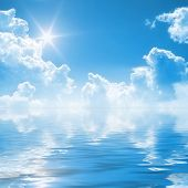 stock photo of sea-scape  - An illustration of a blue sky reflection on the water - JPG