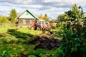 Tractor Plowing A Land, Rural Life In Russia. Concept Of Agriculture, Farming, Agribusiness And Agri poster