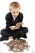 Boy holds money in hands.
