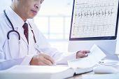 Doctor Analysing Data In Detail poster