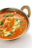 picture of kadai  - butter chicken in kadai on a white background  - JPG
