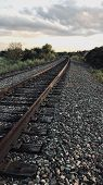 Railroad With An Overcast Sky With Sun Setting. poster