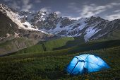 Night Landscape Of Mountains And A Tent Of Tourists In Svaneti, Georgia. Camp In Mountain At Night.  poster