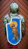Knights Armour Hanging On The Wooden Door