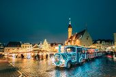 Tallinn, Estonia. Beautiful Train For Sightseeing Near Traditional Christmas Market On Town Hall Squ poster