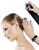 stock photo of hairspray  - Hairdresser fixing coiffure with hairspray - JPG
