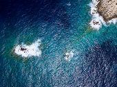 Aerial above rocky coastline poster