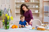 Child Helping Mother Make Cookies In Modern Kitchen. Mother And Son Cooking. Mother And Son Preparin poster