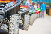 Parked In A Row Several Atv Quad Bikes Extreme Outdoor Adventure Concept. poster