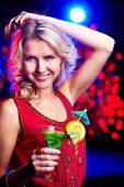 Image of happy girl holding cocktail at party