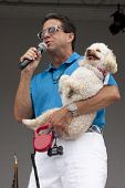 RIDGEFIELD PK, NJ-JULY 14: ABC Channel 7 meteorologist and dog lover, Bill Evans, holding his own do