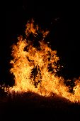 stock photo of splayed  - burning straw left at the field at the night - JPG