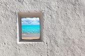 Balearic islands idyllic turquoise beach view through whitewashed house open door [ photo-illustration]