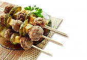 Roast meatballs on skewers