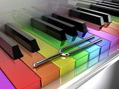 picture of rainbow piano  - Illustration of a silver tuning fork on a multicoloured piano - JPG