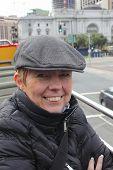 A mature woman wearing a flat cap